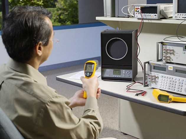 Technician Calibrating an IR Thermometer with an Infrared Calibrator